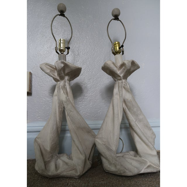 Sculptural John Dickinson inspired table lamps in working condition. Original finials and shades included.