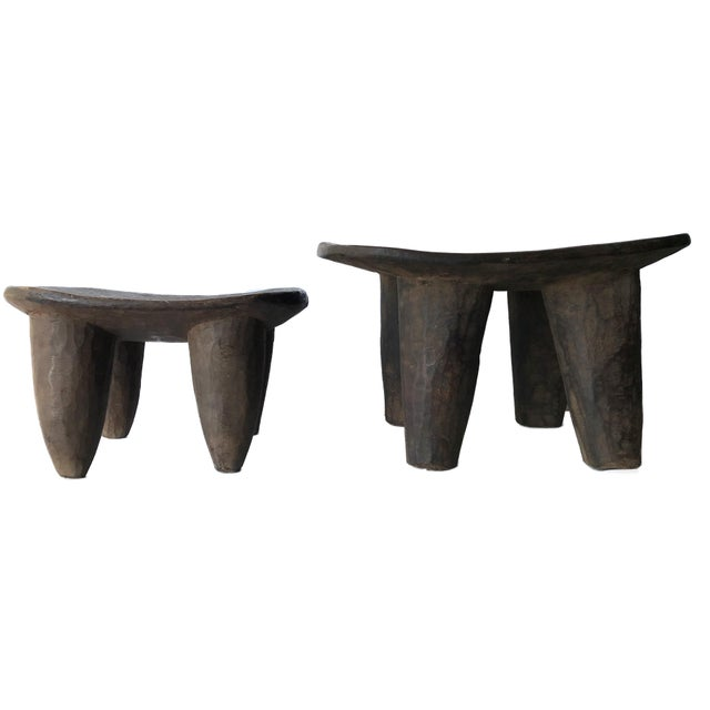 Superb African Senufo milk stools set of two on four tapered legs with an abstract form . Carved from one piece of wood....