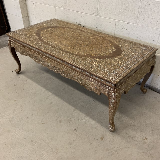 Fantastic bone inlay on teal wood coffee table. Great shape and size. Workmanship is sick. Dense floral and bird pattern...