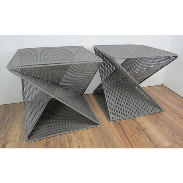 Pair of geometric origami form perforated metal side tables by French designer Mathieu Matégot. These architectural...