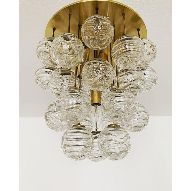 Fabulous brass and murano glass (27 lights) flush lamp from the 1960s made by Doria Leuchten Germany. The structure in the...