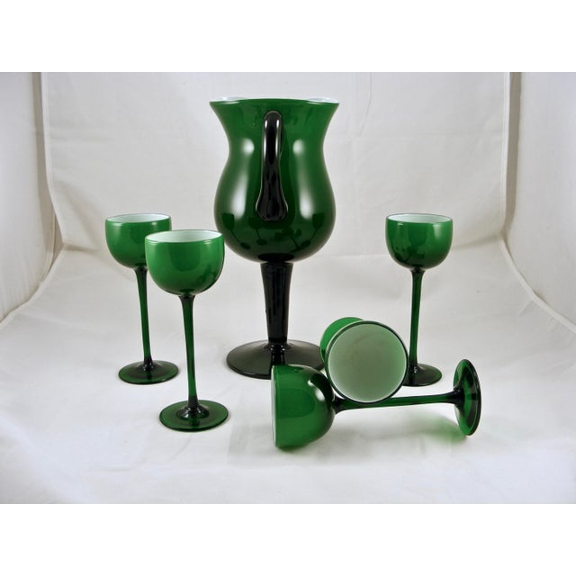 Here is another fabulous Carlo Moretti green/'white cased pitcher with 5 wine glasses. They are in overall excellent...