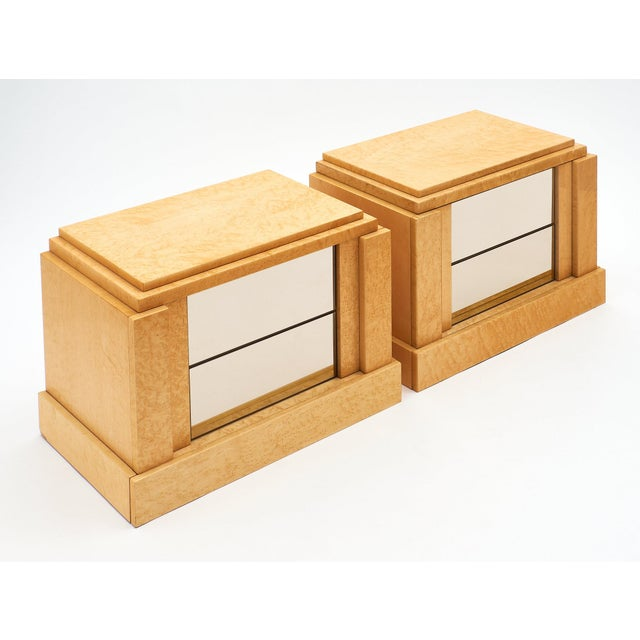 Modernist burl wood side tables made of maple and featuring smoked glass drawer fronts. We love the classic feel of this...