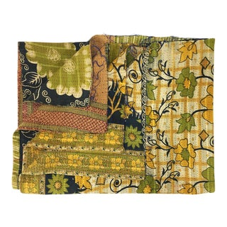Green and Gold Floral Rug and Relic Kantha Quilt