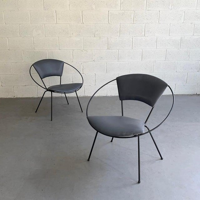 Pair of atomic, mod, mid century modern, wrought iron, hoop chairs upholstered in deep aubergine, gray vinyl. The chairs...