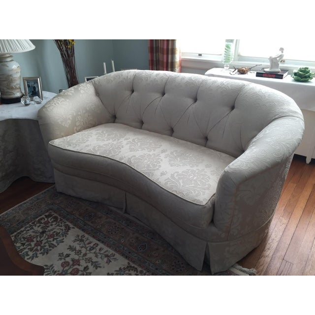 Ivory curved sofa in damask fabric, stickley audi (pair available). The loveaseat is in mint condition with skirt bottom...