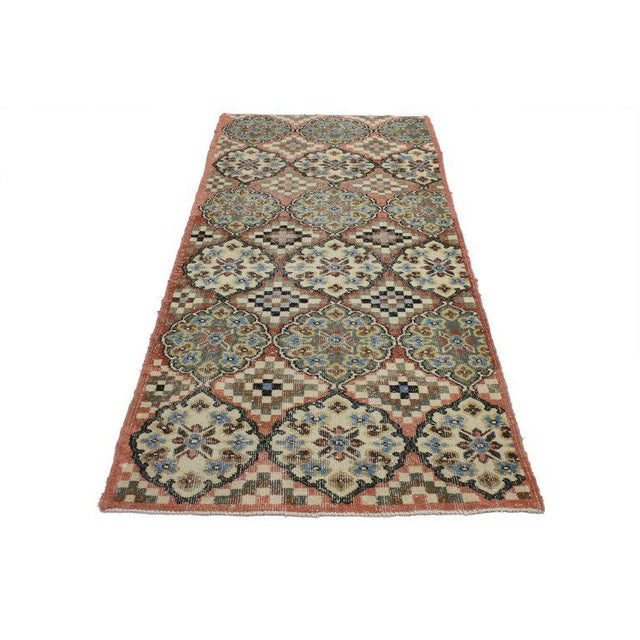 This distressed Turkish Sivas rug features large alternating cusped medallions and stair-step amulets in rows of three in...