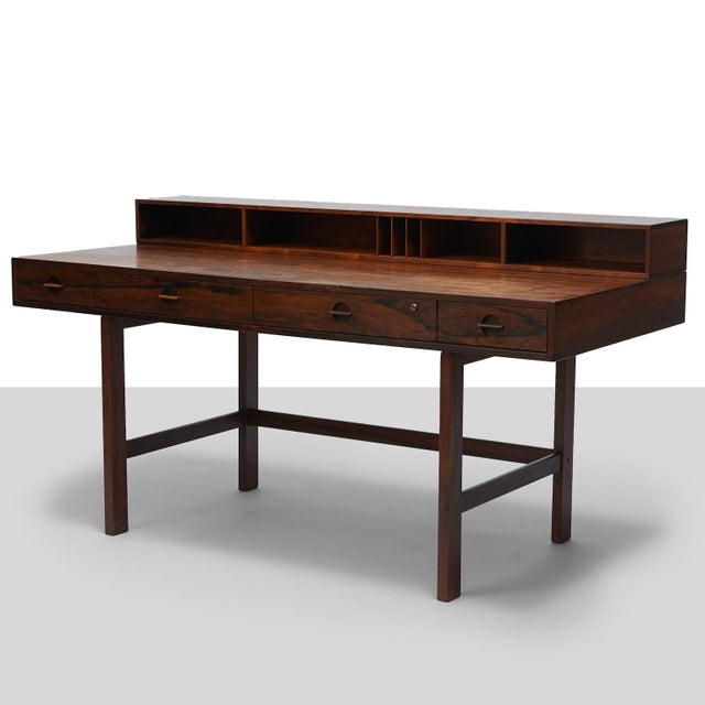 Partners Desk by Peter Lovig Nielsen. A rosewood partner's desk by Peter Lovig Nielsen for Lovig. Slotted and...