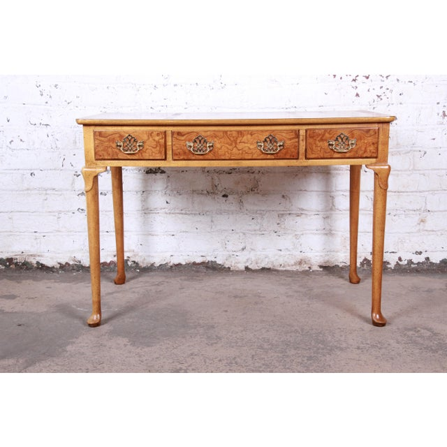 A gorgeous Queen Anne style burl wood writing desk By Baker Furniture USA, Circa 1960s Olive ash burl + brass hardware...