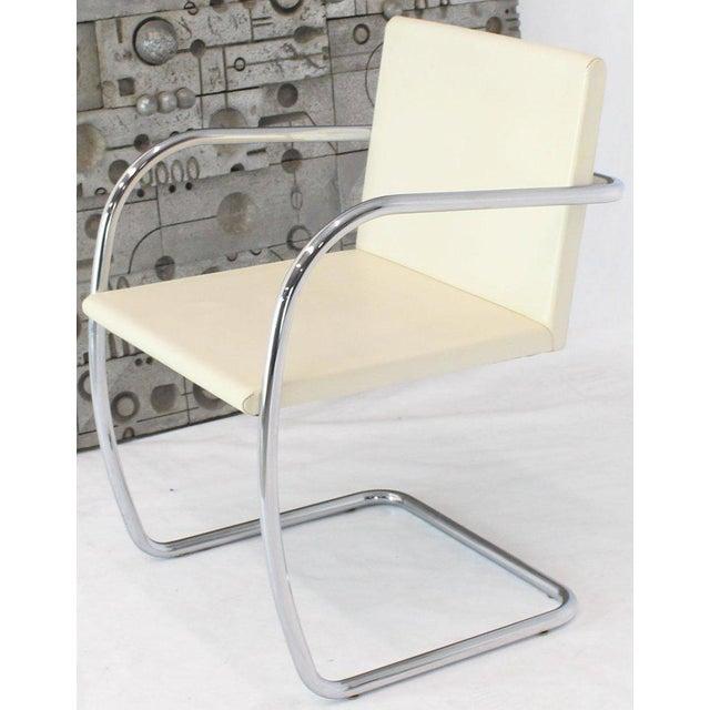 Chrome tubular Brno Mies van der Rohe thin pad off-white leather chairs. This is a super sleek rare thin pad version. Nice...