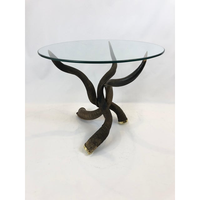 A sculptural custom made tripod coffee table having 3 kudo horns elegantly arranged with tips at the top perfectly poised...