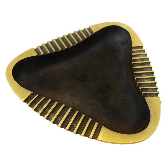"""Patinated brass ashtray in the shape of a rounded triangle designed by Richard Rohac. Signed on bottom. 4.9"""" w x 4.75"""" d x..."""