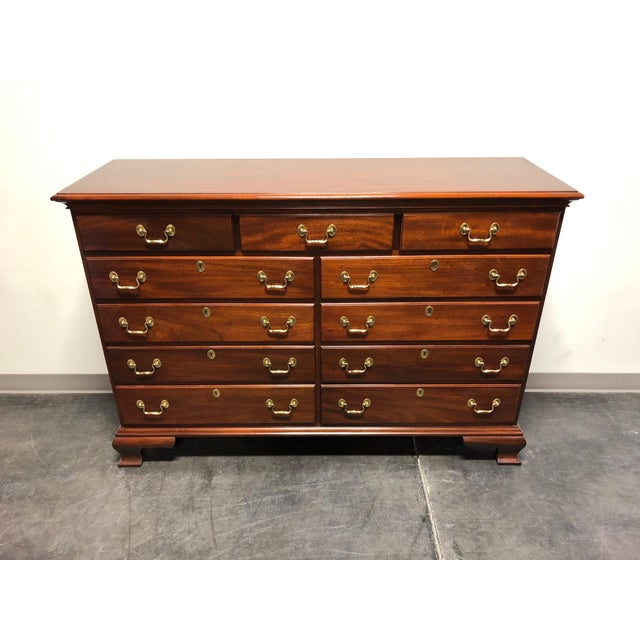 An eleven drawer double dresser in solid mahogany with brass hardware. Made by Councill Craftsment of Councill, North...