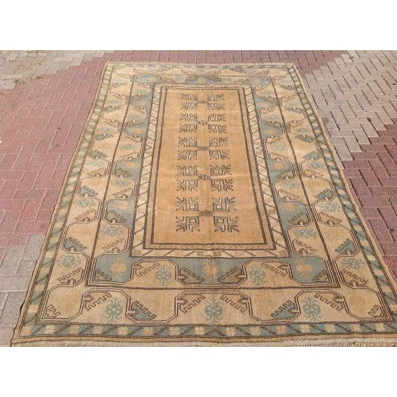 This gorgeous hand-knotted vintage Anatolian runner rug is approximately 70 years old in excellent vintage condition. The...