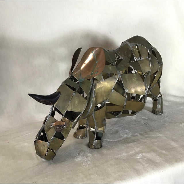 Large Brutalist vintage brass and copper rhinoceros/rhino sculpture from the 1960s. All original patina, not been...