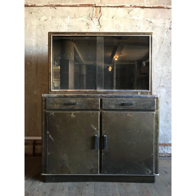 Enjoy this industrial Dry Bar, with a rustic and aged feel, cabinet space, and a metal frame it will fit handsomely in any...