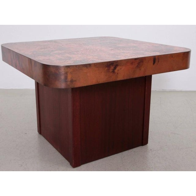 Coffee or side table with copper tabletop and mahogany base by Bernard Rohne. The table is from the 1960s and it´s in a...