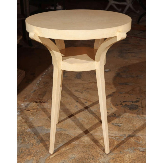 Restored sculptural side table refinished in a faux painted parchment.