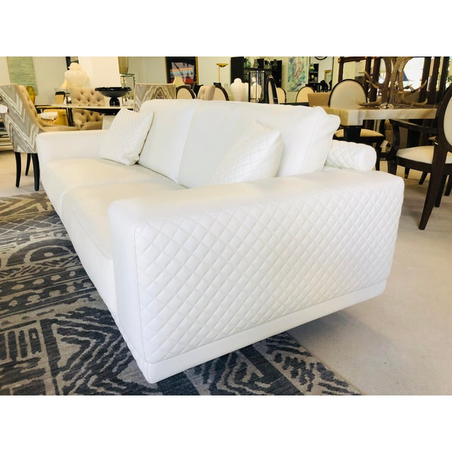 White leather, Coco Chanel Style hand-stitched pattern. Black painted wood legs. Imported from Italy. Matching chairs (x2)...