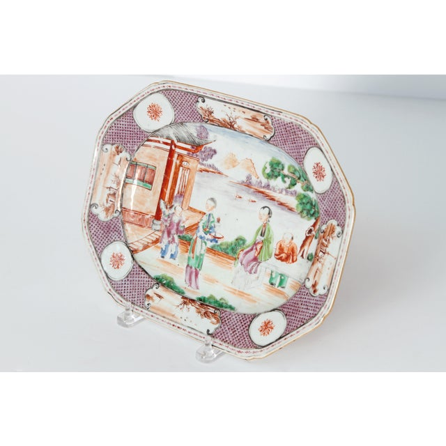 A beautiful Chinese Export hand-painted porcelain platter in the Manderin palette, with red scale and plumb depicting a...