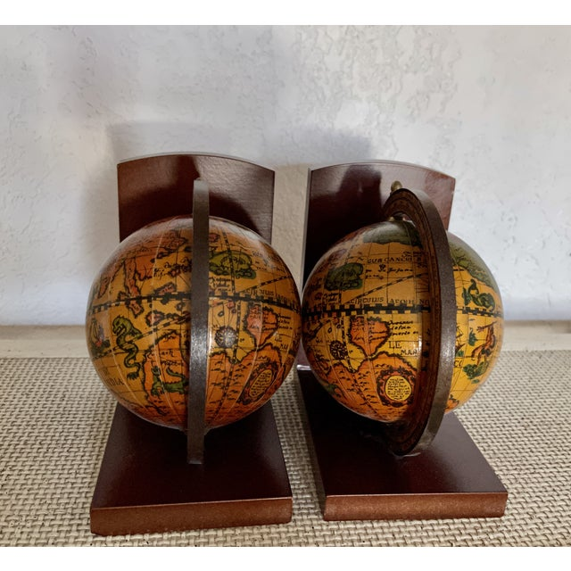 A Pair of Vintage Old World Rotating Globe Bookends. Made in Italy A perfect addition to any bookshelf around the house....