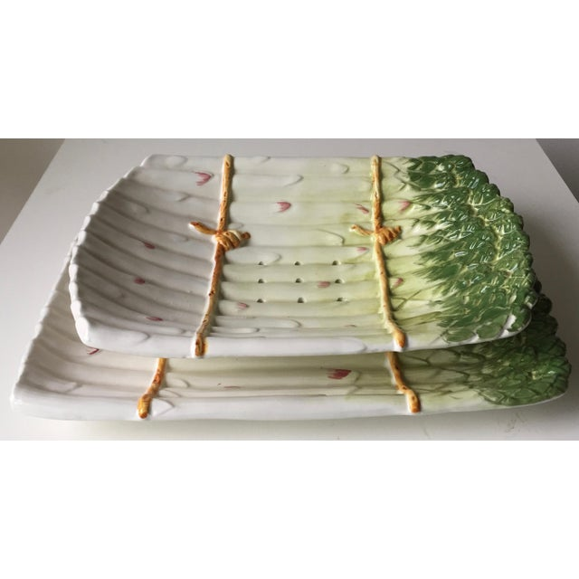 This wonderful set of hand-painted faience ceramic asparagus serving dishes includes a strainer bowl with matching...