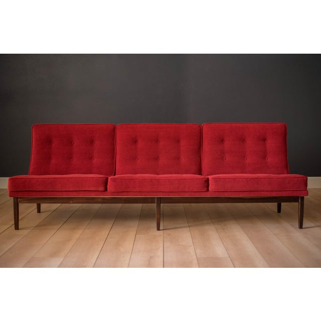 Mid-Century Modern sofa by Florence Knoll for Knoll, model 2553 RW. This piece was designed with a custom rosewood frame...