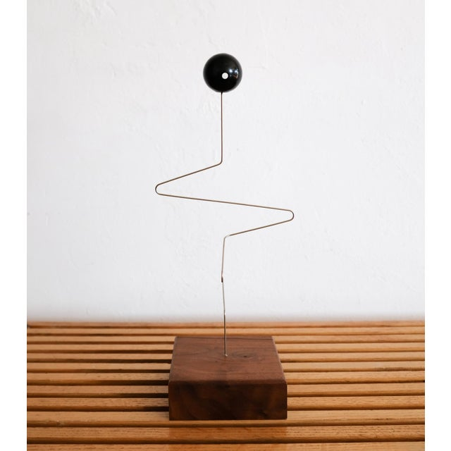 """""""Tork"""" kinetic sculpture by Donald Max Engelman. The weighted resin ball bounces in all directions when deployed. The..."""