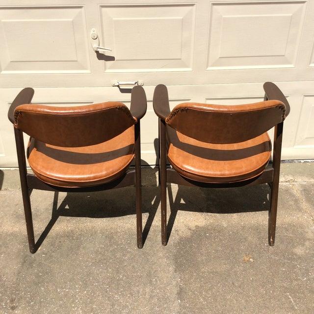 Vintage Paoli Chairs. Nail head trim on back.