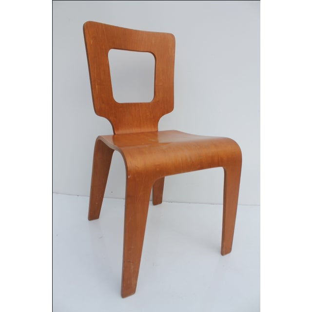 A vintage, Mid-Century Modern Bentwood birch plywood accent or desk chair by Thaden Jordan Furniture . Shows some typical...