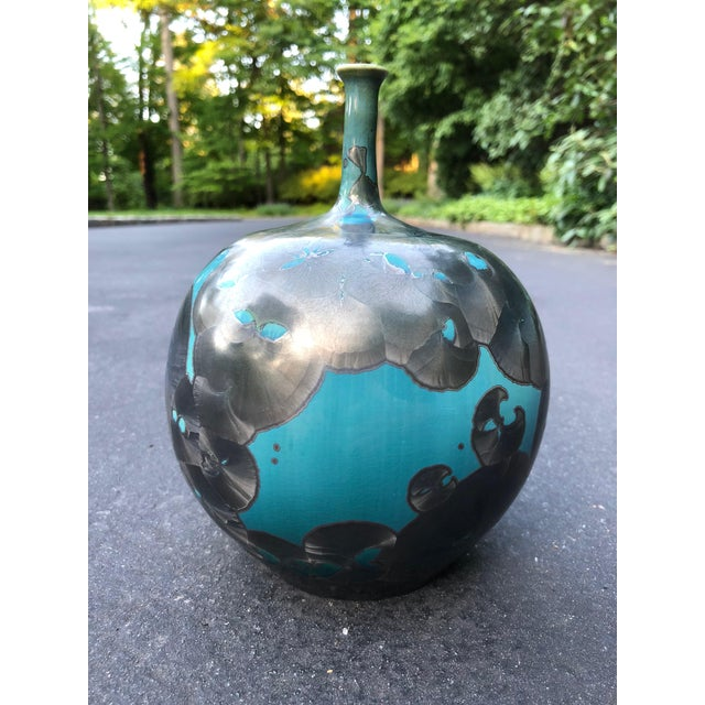 Vibrant blue and gray crystalline glazed sculpture/vase. Handthrown with porcelain.
