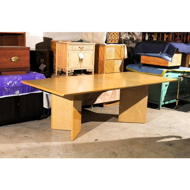 A fabulous Modern knife edge extension dining or conference table, circa 1980. Beautiful Birdseye Maple veneer with...