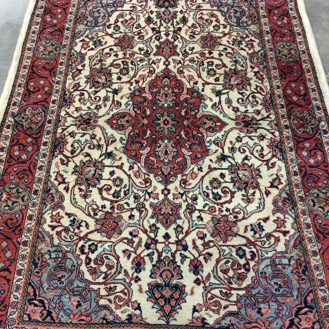 This is a vintage Saroukh Persian rug from the 1980s. The piece features a medallion and is rendered in shades of beige,...