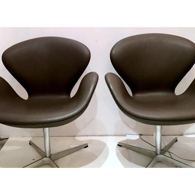 Arne Jacobsen for Fritz Hansen Swivel Swan Chairs - A Pair - Image 4 of 9