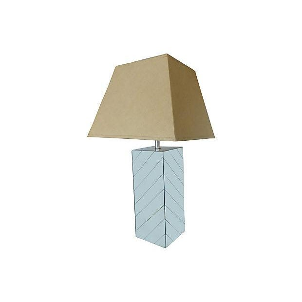 Tall table lamp with diagonal mirrors covering four sides. Top is chromed metal. Original working wiring; uses standard...