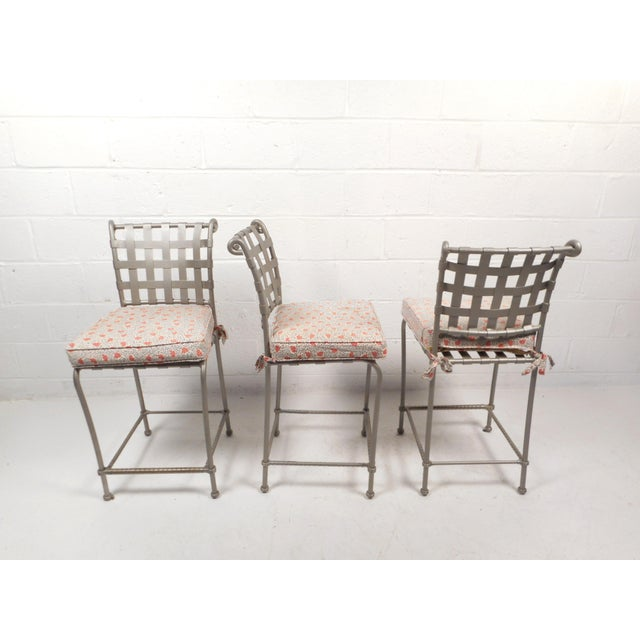 This beautiful set of three contemporary modern bar stools feature metal frames and scroll detail on the backrest. Sleek...