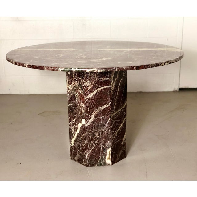 We are very pleased to offer an extraordinary, sleek Italian travertine stone dining table, circa the 1970s. With its...