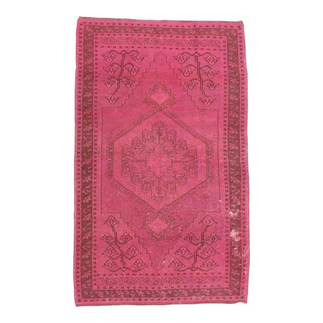 Vintage hand-knotted decorative modern fushia overdyed Turkish area rug For Sale