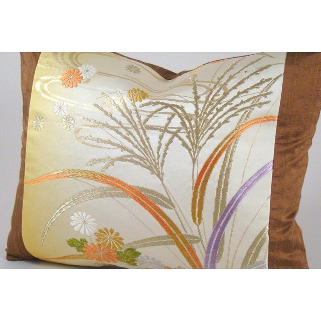 This limited-edition pillow cover is fashioned from a vintage Japanese silk brocade obi depicting delicate autumn grasses...