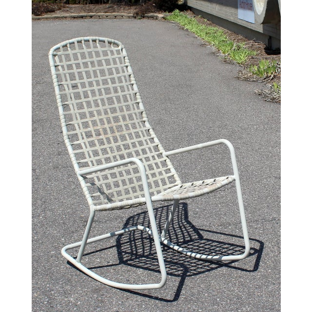 For your consideration is an outdoor patio rocking chair by Brown Jordan from the Kantan series, circa the 1960s. In...