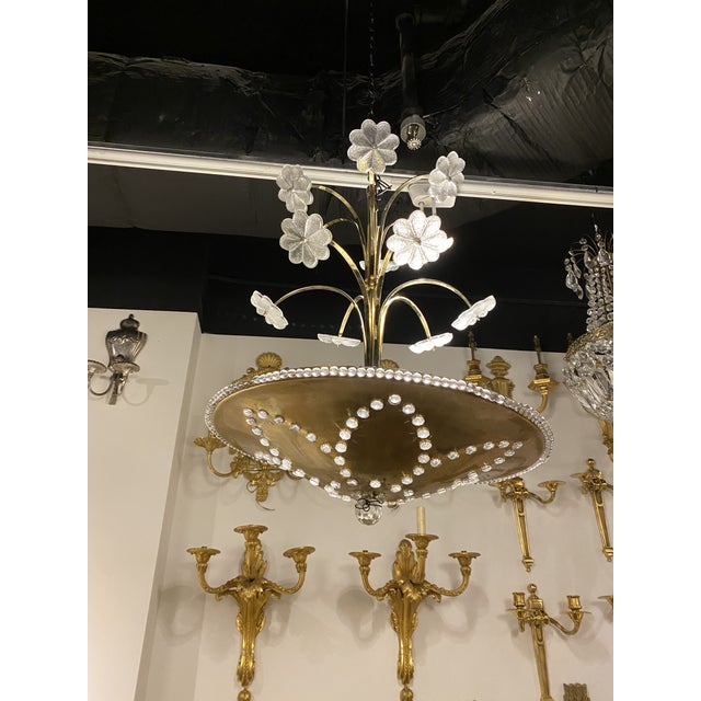 A circa 1930 's French bagues light fixture with interior lights and Murano flowers.