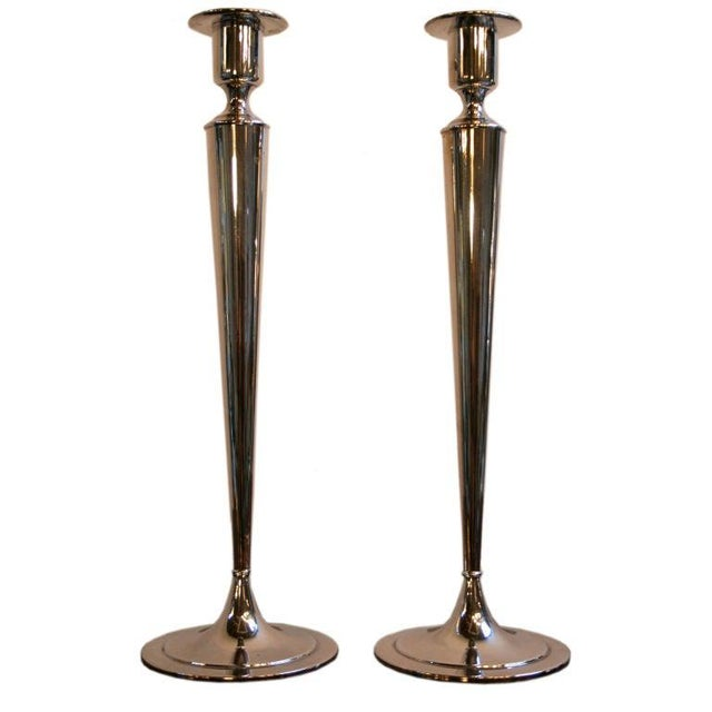 Pair of 1960s silverplated Fairpoint candlesticks. Elegant, beautiful addition to a modern home.