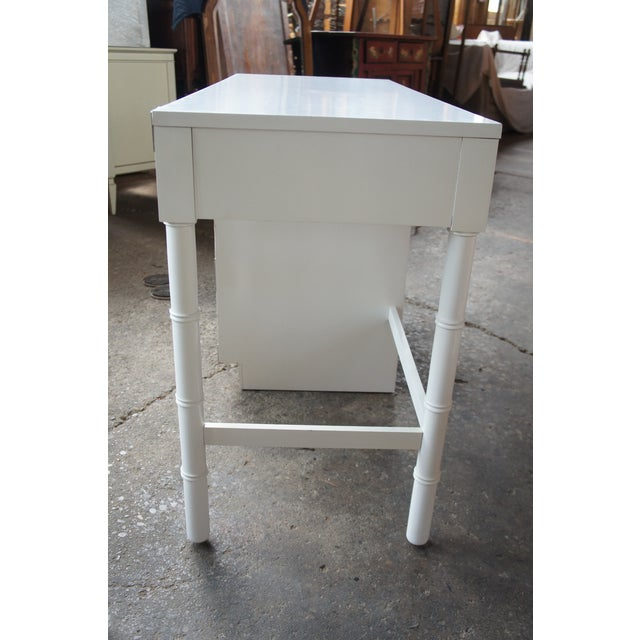 Campaign desk and chair set in off-white by Dixie from the Campaigner collection. Features silver tone hardware, bamboo...