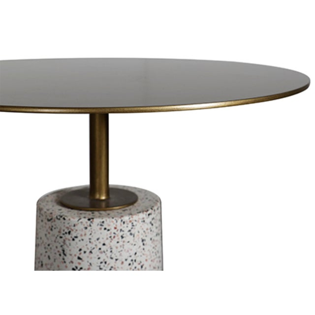 Contemporary terazzo style concrete base with antique brass finish metal top round side table. Perfect for use indoors or...