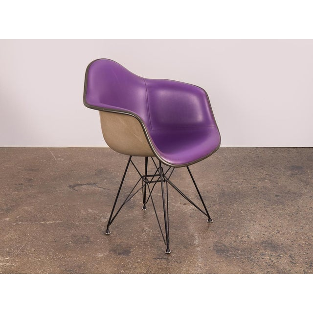 1960s Padded Eames Armshell Chair on the black eiffel base. In a stylish, rare purple color! The padded vinyl is in good...