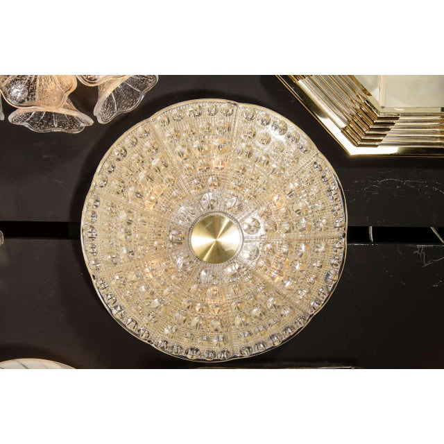 Mid-Century Modernist flush mount chandelier by Carl Fagerlund for Orrefors. This flush mount features a stunning pressed...