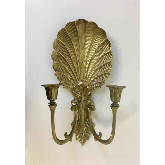 Elegant vintage heavy solid brass shell wall sconce candle holder with 2 arms that hold tapered candles. In excellent...