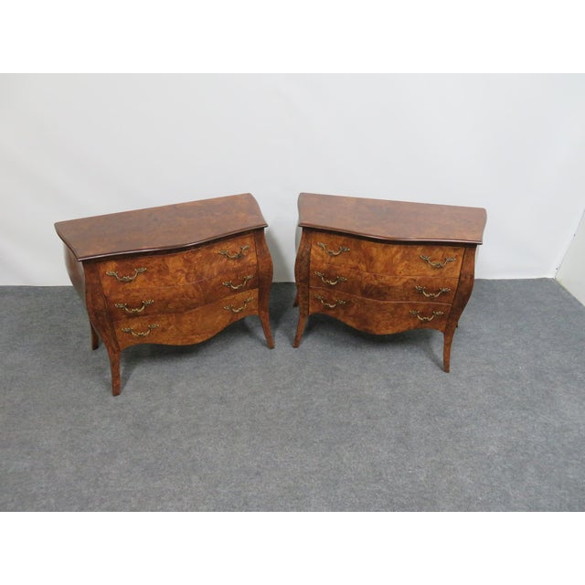 Pair of Italian burl wood bombe' form Nightstands , each has 3 drawers, paper lined , with brass hardware