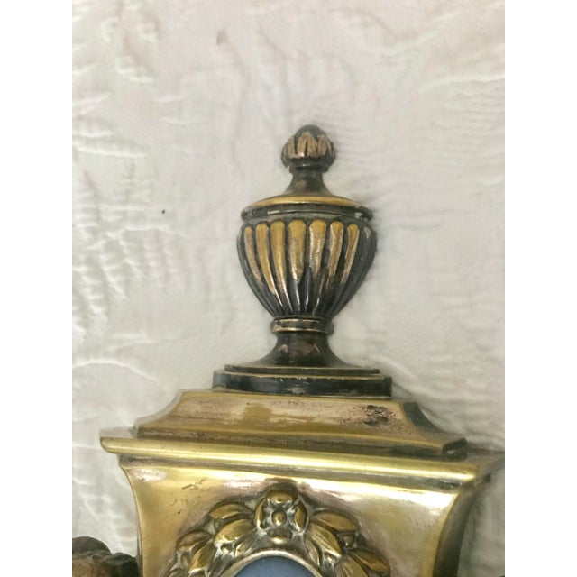 These are a set of 4 Empire double arm brass sconces with blue Wedgwood Jasperware plaques. They all have Rams heads and...