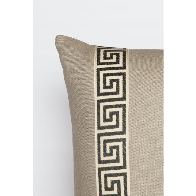Pair of custom cream linen pillows with coordinating black-and-ivory colored Greek key tape on fronts. Solid cream linen...